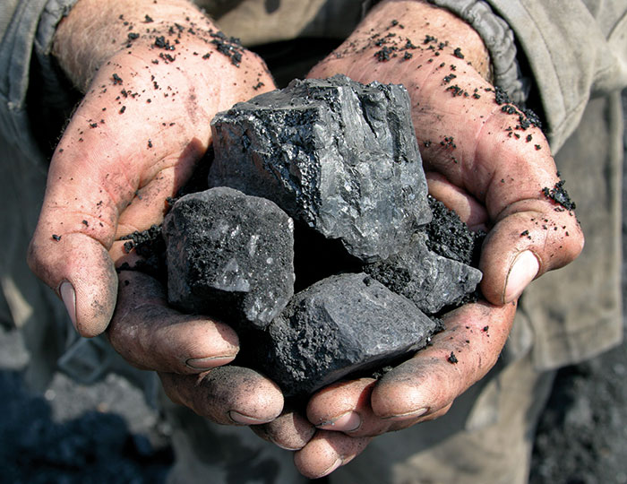 Hands holding iron ore