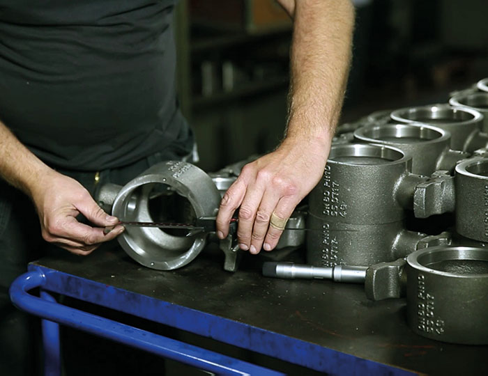 Hands using measuring tool for quality assurance on a Ramén Ball Sector Valve